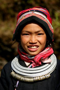Asia | Portrait of a Dao Ao Dai girl wearing traditional clothes and headscarf, Vietnam | © Rudi Roels