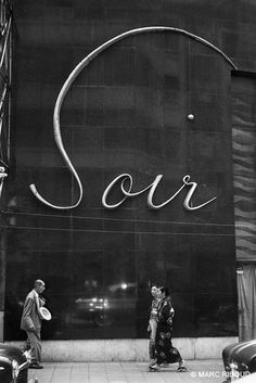 Tokyo, 1958. Paris is during one year in the fashion of restaurants and places of pleasure in Tokyo. Japanese transform our alphabet into a smart calligraphy.  Marc Riboud