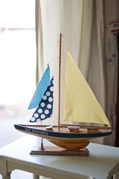 DIY vintage sailboat re-do. Would be cute naming the boat last name of son's first name!