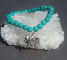 Turquoise howlite boho bracelet with a elephant.  Love this calming blue.Small…