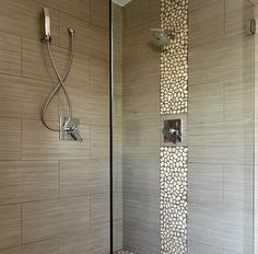 A truely remarkable shower room with a pebble wall effect designed and built by W8 esign Build Maintain Ltd.