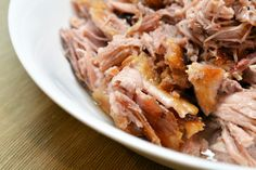 Slow Cooker Kalua Pig - Boston Butt, bacon, coarse or fine sea salt, cloves of garlic (optional). So simple and most ingredients you already have on hand!