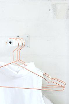 white blouse on copper hanger | wardrobe . Garderobe . garde-robe | Photo: Ivania Carpio |