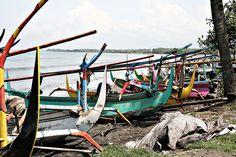Fisher boats rest in Medewi beach