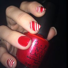 Christmas nails...i like the idea, but it bothers me very much that one nail doesn't have the white stripes.