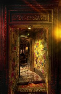Patchwork wall; appears to be fabric.  Bohemian Valhalla: Interior Alchemy... Color Me Speechless!