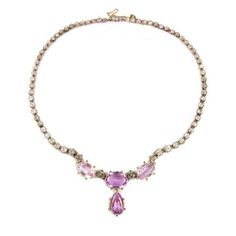19th century pink topaz and diamond collet necklace, c.1880, to the front three oval facetted pink topaz with diamond set trefoil clusters in between, a pear shaped topaz hung to the centre, each topaz with rose cut diamond highlights spaced around, on a graduated cut-down collet diamond necklace, open set in silver and gold.