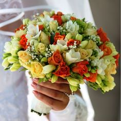 Royalty Free Photo of a Bride's Hand Holding a Bouquet Blue Rose Bouquet, White Peonies Bouquet, Table Arrangements, Flower Arrangements, Blonde Bride, Cream Color Dress, Summer Wedding Bouquets, Close Up Photography, Gypsophila