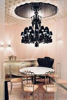 Tufted ceiling, black chandelier & ceiling medallion, pink curtains.  Glamor
