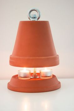 : Tealight oven for warm winter evenings kitchen wreaths Tealight oven I flower pot heater My Flower, Flower Pots, Diy Projects For Beginners, Modern Planters, Cabinet Makeover, Clay Pots, Diy Wreath, Diy Bedroom Decor, Home Decor