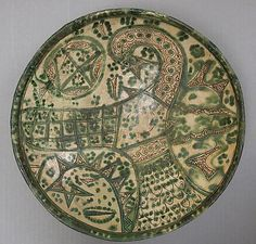 Bowl with Stylized Bird    Object Name:      Bowl  Date:      11th century  Geography:      Iran  Medium:      Earthenware; incised decoration through a white slip and color glazes under a transparent glaze (Amul ware)  Dimensions:      H. 3 7/8 in. (9.8 cm) Diam. 13 1/16 in. (33.2 cm)  Classification:      Ceramics