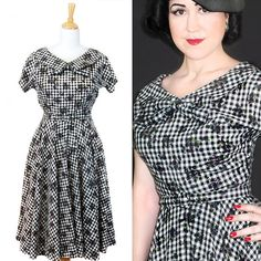 Authentic reproduction of a 1954 design. This dress features a dolmen sleeve, metal size zip and covered belt!!  esty.com/EvelynWoodVintage