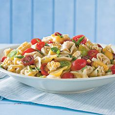 24 Ways with Fresh Tomatoes   Tortellini-and-Tomato Salad   SouthernLiving.com -- oh my goodness so yummy and fresh