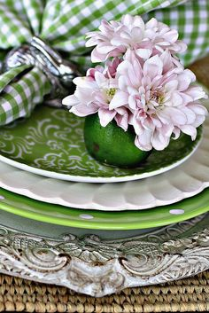 Fruit Flower Vase and layering of plates with different patterns and textures ( a lime is used as a vase)