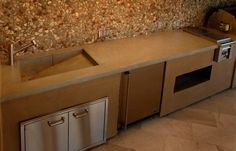 Outdoor Kitchen Ideas: Concrete Counter with integrated sink, sink slants down from counter to drain.
