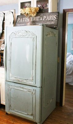 Trois Petites Filles- Love how this fridge was camouflaged! My hubby would never let me do this.