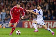 Gareth Bale skips past a Cyprus defender.