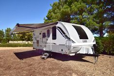 The Lance 1985 Travel Trailer comes with a large awning allowing for plenty of outdoor shade! Ultra Lite Travel Trailers, Outdoor Shade, Rv Accessories, Recreational Vehicles, Oasis, Hunting, Gallery, Fishing, Campers