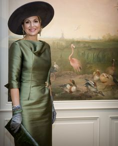 Queen Maxima wore gray leather gloves with her olive-green dress while attending the opening of 'A Royal Paradise' exhibition.