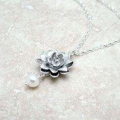 Lotus Flower necklace, I so want one.