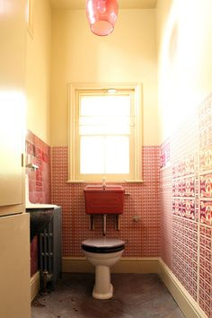 Look at all the retro fixtures and that AMAZING wallpaper treatment. By Retrouvius.