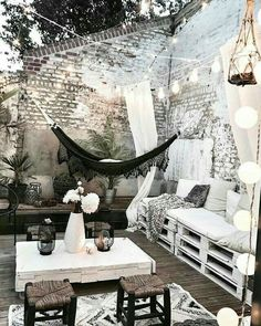 Perfect patio terrace porch for parties or lounging. Tall whitewashed brick wall for privacy and ambiance. Hammock and palette furniture to lounge in on the wooden wood deck. Home design decor inspiration ideas. Home Design Decor, House Design, Design Ideas, Interior Design, Modern Interior, Modern Decor, Design Projects, Winter Balkon, Outdoor Spaces