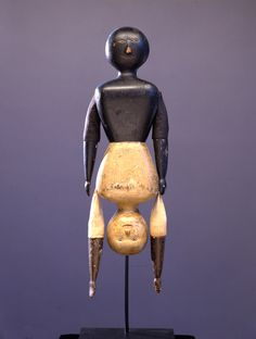Topsy Turvy Doll, Circa 1900. Carved wood with polychrome and fabric. Signature work from the Mendelsohn Collection