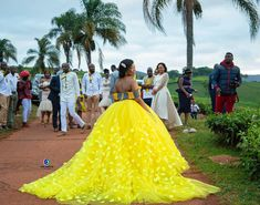 Image may contain: 4 people people standing wedding and outdoor African Bridal Dress, African Wedding Attire, African Prom Dresses, Latest African Fashion Dresses, African Print Fashion, African Attire, African Dress, African Traditional Wedding Dress, Traditional Wedding Attire