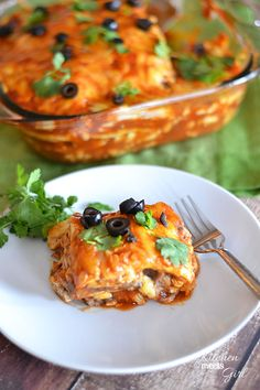 This Cheesy Chicken Enchilada Casserole uses a quick and easy marinade that comes together in a snap, and makes dinnertime a breeze! #recipe #chicken #casserole #mexican
