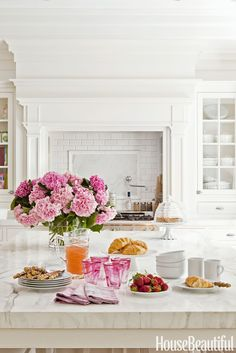 Modern Kitchen Design Classic white kitchen with mantle over range, glass front cabinets for whitewall collection, and of course, pink peonies! - Tempered with hints of black and white, this home is feminine without being overly sweet. Design Your Kitchen, New Kitchen, Vintage Kitchen, Kitchen Vent, Kitchen Designs, Kitchen Utensils, Kitchen Mantle, Kitchen Decor, Kitchen Ideas