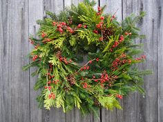 Traditional with a twist! Bittersweet, Rose Hips, Lime shaded cypress and cryptomeria laid on a base of fragrant Fraser Fir. All of the materials