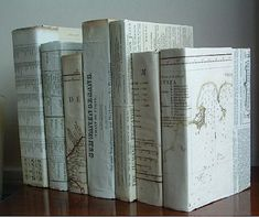 Books covered in antique maps......love this idea, but I would also use some Briwax and give the paper covers a darker, richer glossy finish.