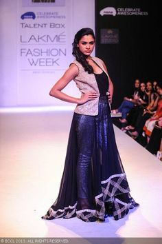 A model showcases a creation by designer Ritika Mirchandani on Day 6 of the Lakme Fashion Week Winter/Festive 2013. #Fashion #Style #LFW