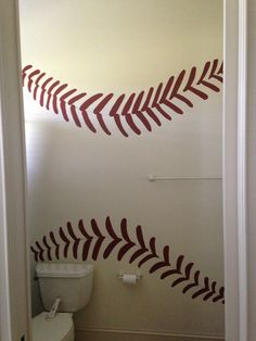 Baseball laces I painted on the wall in the bathroom for my sons baseball themed bedroom