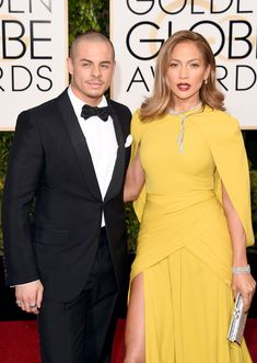Jennifer Lopez and her boyfriend, Casper Smart, looked incredible at the Golden Globe Awards. Our favorite couple, who always look great cozying up as they pose for photos, made our jaws drop with their fashion choices. Jennifer shocked us in a mustard covered-up yellow Giambattista Valli dress — actress America Ferrera rocked a very similar color — and 200 carats of dazzling Harry Winston diamonds, looking like Hollywood royalty next to her tuxedoed and bow-tie clad man.