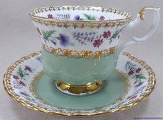 I have this set.....each cup and saucer is a different pastel color.