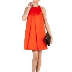 """TED BAKER orange swing cocktail dress 0 XS This is a stunning, unique Ted Baker party dress for spring and summer! BRIGHT orange cotton/poly matte satiny material is super thick and structured. The dress is fully lined and pleats make it lay nicely on your frame. Size Ted Baker 0 - true to size for brand and fits typical 0/2/XS. 31"""" bust, 25"""" waist, 34"""" length - loose swingy hips. FLAWLESS - no rips, tears, stains, holes or other imperfections - it will just need steaming! FOR PHOTOS OF THE…"""