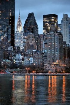 dusk~Manhattan Island as seen from Roosevelt Island across the East River in New York City • photo: JC Findley on FineArtAmerica