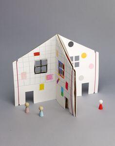 The Dollhouse Book / Rock & Pebble Gewoon een opschrijfboek schuin in een snijmachine doen toch?