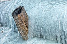 Frozen - Frozen creek small waterfall in mountains winter time