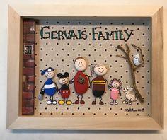 Painted pebble art whimsical family who loves Harry Potter, Mickey Mouse and the Ottawa Senators.