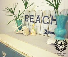 Love the beach sign.  Might have to find a mini adirondack chair instead of the florida chotchke.