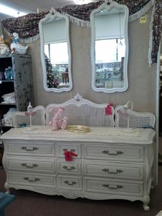 "$349 - This is a 9 drawer French Provincial dresser, all original metal hardware. It has been painted creamy white and has had a dark wax hand applied. Two wall hanging mirrors, also painted and waxed. Behind the dresser is a king size headboard, it is available for $99. These pieces can be seen in booth A8 at Main Street Antique Mall, 7260 E Main St (E of Power Rd) Mesa, AZ 85207 - 480-924-1122 open 7 days a week 10a.m. to 5""30p.m. - Cash, Charge or 30 day layaway available."