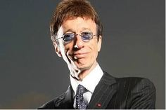 Designer suit and blue shades #RobinGibb #BeeGees