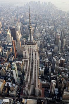 The Empire State Building stands in this aerial photograph taken over New York, U.S., on Wednesday, July 7, 2010. Photographer: Daniel Acker/Bloomberg #