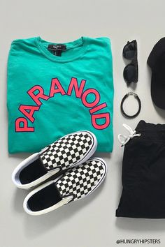 """A cotton knit tee featuring a front """"Paranoid"""" graphic, a right """"Blessed"""" sleeve graphic, a left """"Revenge"""" sleeve graphic, ribbed crew neckline, long sleeves with ribbed cuffs, and a loose silhouette."""