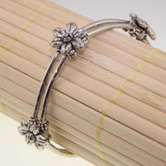 @Overstock - This handmade Tibetan silver bracelet features Tibetan-style carving and design that will add that special touch to any look. Let this gorgeous piece of jewelry become the next treasured piece of your collection.http://www.overstock.com/Worldstock-Fair-Trade/Tibetan-Silver-Flowers-Bracelet-China/5986680/product.html?CID=214117 $18.99