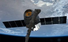 NASA picture of the SpaceX Dragon commercial cargo spacecraft grappled to at the International Space Station