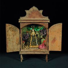 Virgen de Soledad Nicho  Oaxaca, Mexico, 1st half 20th cent.  Mixed media - Wood, gesso and paint figure with fabric, paper, tin-foil in wood and glass box.