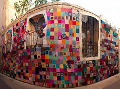 Yarn bombed building in the old quarter of Zaragoza, Spain. More than 1,000 20 x 20 squares cover 50 square meters. 100 women knit for almost 6 months to make this happen.